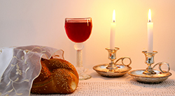 Shabbat candles, wine, and challah