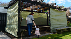 Mother and child in a sukkah