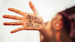"a woman's hand with the message, ""believe in your dream"" written on it"