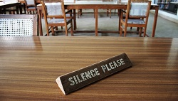 "Sign that says ""silence"" in a library"